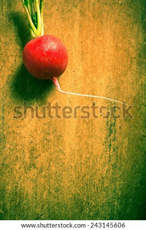 red radish over wooden background in old style coloring and copy space - stock photo