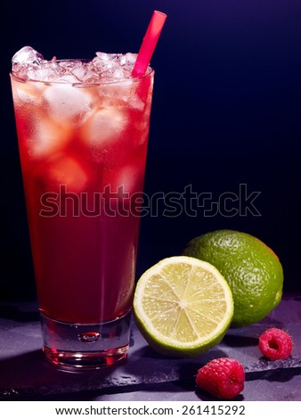 Red raspberry drink  with green lime on black background. Cocktail card 11. - stock photo