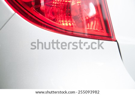 red rear stop lights on the white car, close view - stock photo