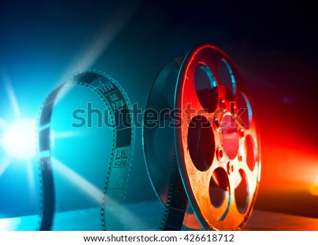 Red reel of film on a dark background