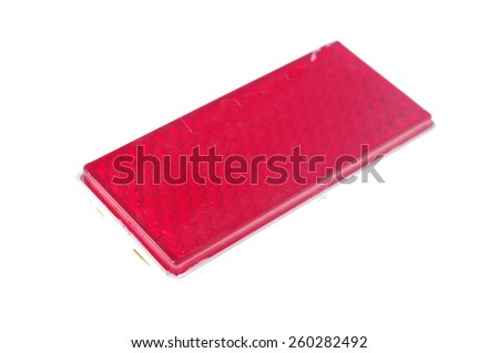 red reflective car light isolated on white  - stock photo