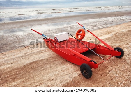 Red rescue boat on the beach.