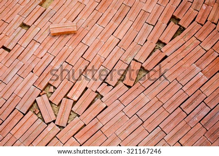 Red retro antique brick blocks floor unorganized for texture wall background - stock photo