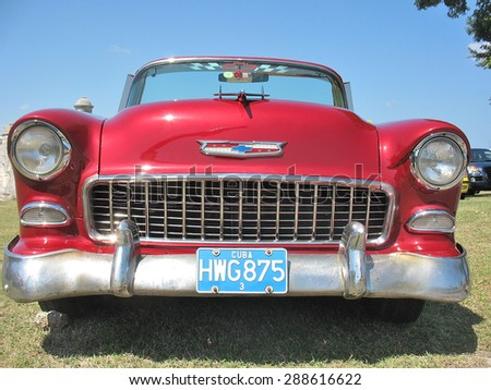 Red retro car in Havana, Cuba in the center of the town on May 6, 2009. - stock photo