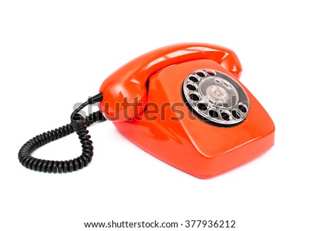 Red retro telephone isolated on white background
