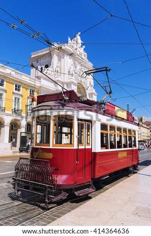red retro tram Commerce Square in Lisbon - stock photo