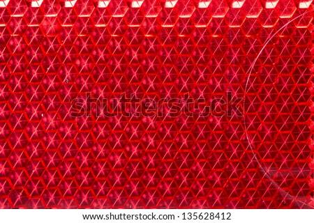 Red retroreflector macro texture - stock photo