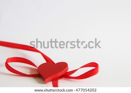 Red ribbon frame with heart,  isolated on white background. Love
