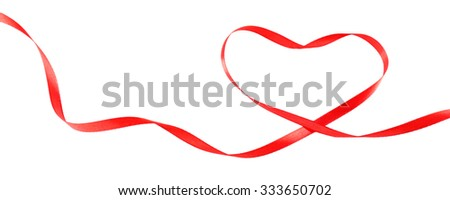 Red ribbon in shape of heart isolated on white - stock photo