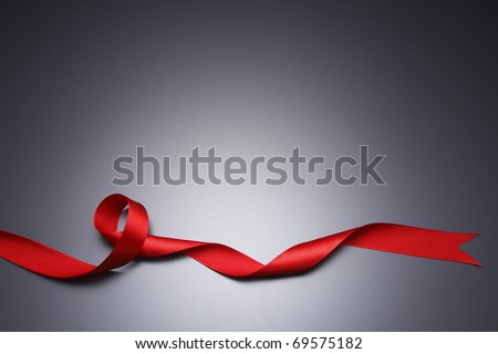 Red ribbon isolated on the black background. - stock photo