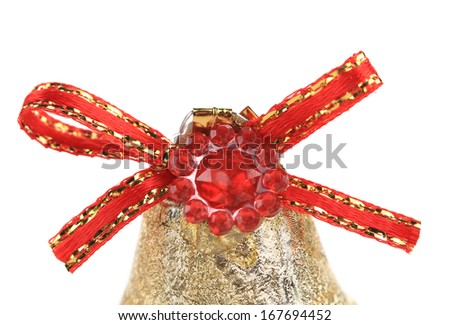 Red ribbon on Christmas kingle bell. Isolated on a white background. - stock photo