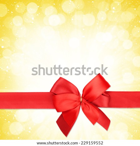 Red ribbon with bow over christmas snow background with copy space - stock photo