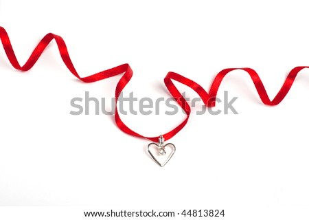 Red ribbon with heart, Isolated over white - stock photo