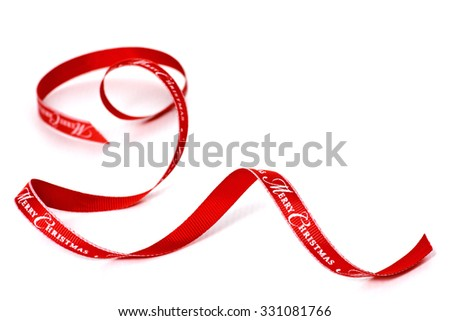 Red ribbon with merry Christmas text, isolated on a white background