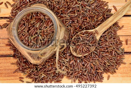 red rice on wooden table
