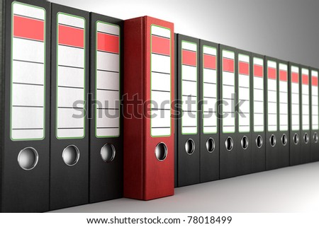 Red ring binder standing out from a row of dark binders - stock photo