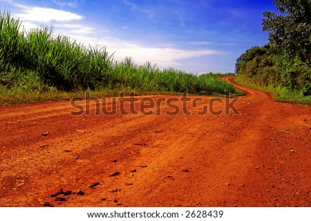 Red road in Africa. - stock photo