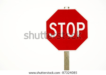 Red Road Stop Sign Isolated Sign Post intersection Snow Storm - stock photo