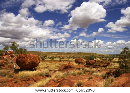 Red rock formations of the Devil's marbles or Karlu Karlu in the Northern Territory of Australia - stock photo