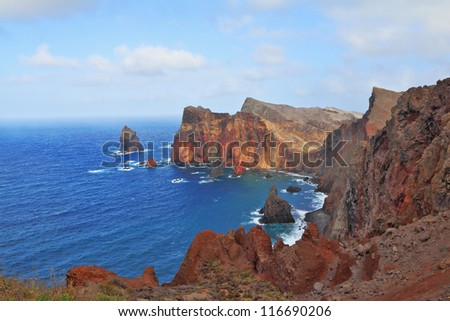 Red rocks and blue sea. Eastern end of Madeira Island at sunset. Atlantic Ocean