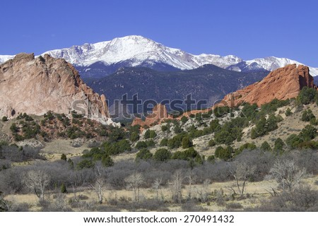 Red rocks at Garden of the Gods in Colorado Springs with Pikes Peak in background. - stock photo