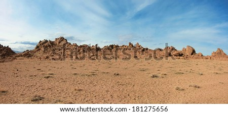 Red rocks in the barren sands of the Gobi Desert