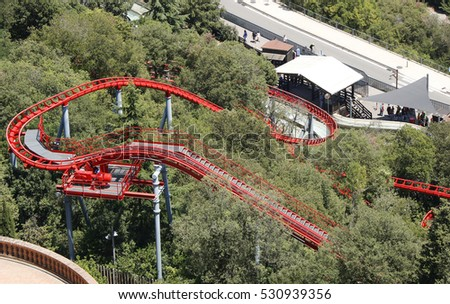 Red rollercoaster track in Tibidabo, Barcelona, Catalonia, Spain, July 2016