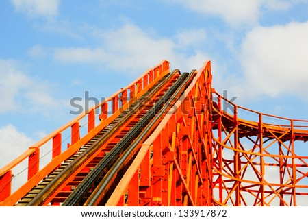 Red rollercoaster with chain and track - stock photo
