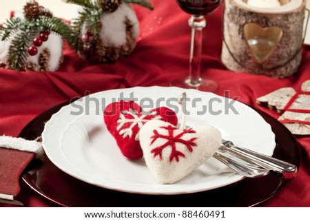 Red, romantic place setting for christmas or celebration wit white and red heart - stock photo