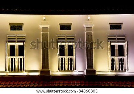 Red roof Colonial white shop house in Singapore - stock photo