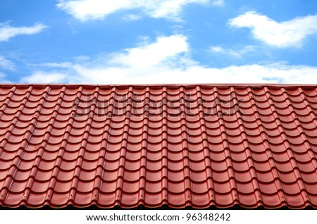 red roof with blue sky - stock photo