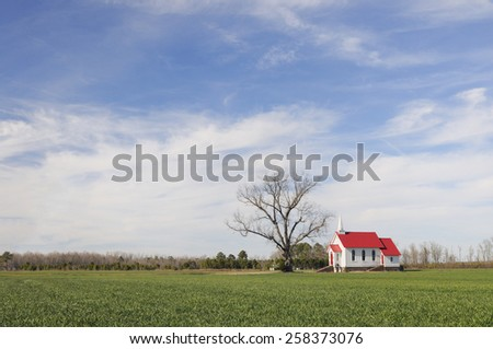 Red Roofed Church in Rural Setting - stock photo