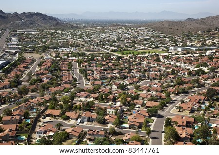 Red Roofs and Swimming Pools against the Phoenix, Arizona Skyline - stock photo