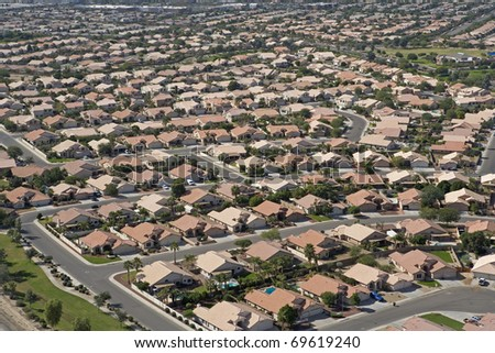 Red Roofs under Blue Skies, Suburbia in Arizona - stock photo
