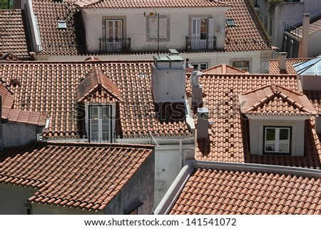 Red rooftops of the sunny city of Lisbon, Portugal - stock photo