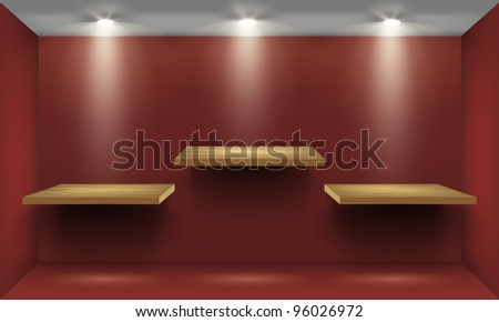 Red room with three empty wooden shelf, illuminated by searchlights. - stock photo
