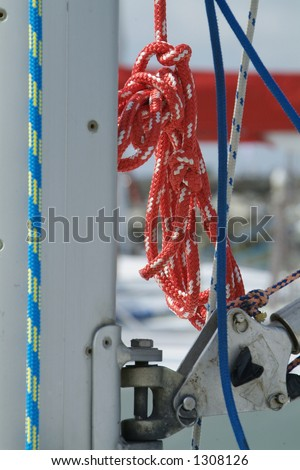 Red rope hanging from the mast of a racing yacht