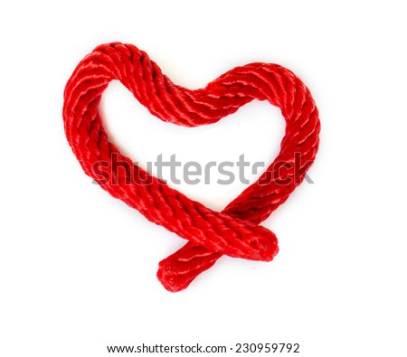 Red Rope in heart shape Isolated On White Background . - stock photo