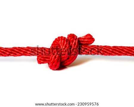 Red rope with a knot isolated on white Background .