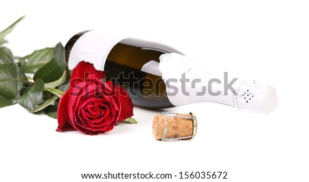 Red rose and a bottle of champagne. Isolated on a white background.