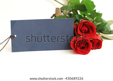 Red rose and empty tag for your text - stock photo