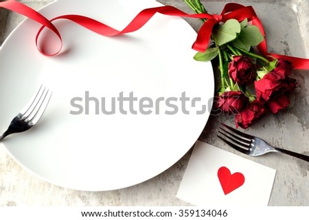 Red rose bouquet with white dish.Image of meal for Valentines day - stock photo