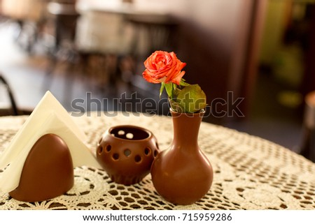 Red Rose In A Vase With A Candlestick And Napkin On Table With Lace  Tablecloth