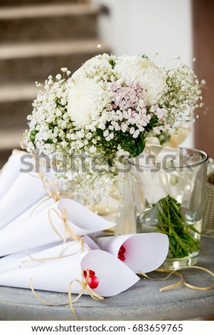 Red rose petals white paper cones stock photo download now red rose petals in white paper cones and flower bouquet preparation for the wedding ceremony mightylinksfo