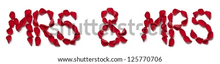 Red rose petals spelling mrs and mrs on white background - stock photo