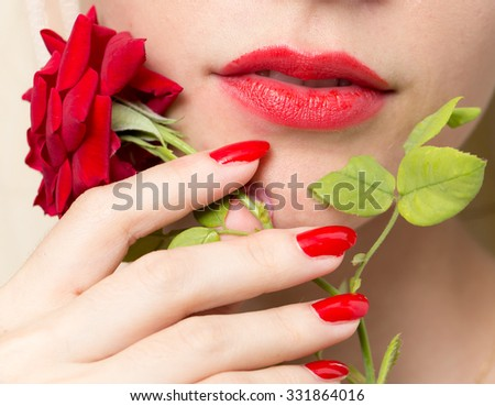 red rose, red manicure and red lips - stock photo