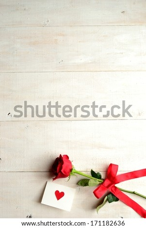 Red rose with message card.Image of Valentines day - stock photo