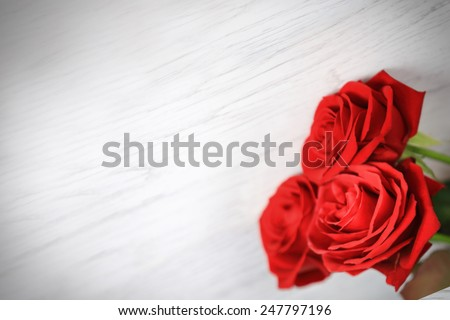 Red roses and a heart on wooden board, Valentines Day background, wedding day - stock photo
