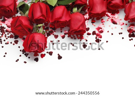 Red roses and heart shape ornaments on white background - stock photo