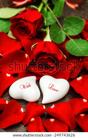 Red roses and two white hearts. Valentines Day decoration. Sample text With Love - stock photo